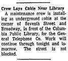 Crew Lays Cable near Library